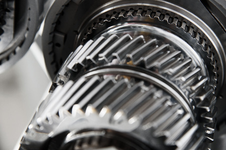 Full frame Industrial background - gear metal wheels in close-up ( selective focus). Stock Photo