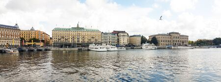 Stockholm, Sweden - August 09, 2019: Wide panorama of Stockholm waterfront with various cruise ships and historical buildings with famous Grand Hotel. Redakční