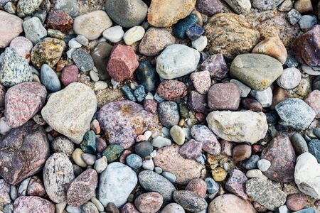 Full frame background of colorful sea stones in close-up on a Baltic coastline Stock fotó