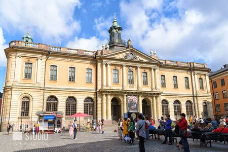 Stockholm, Sweden - August 09, 2019:  Tourists visiting Swedish Academy on Stortorget Square in Old Town of Stockholm. Editorial