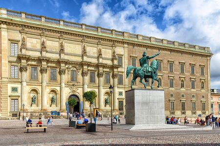 Stockholm, Sweden - August 09, 2019: Tourist visiting Royal Palace and the equestrian statue of the Swedish king Karl XIV sculpted by Johan Bengt Fogelberg in Stockholm.