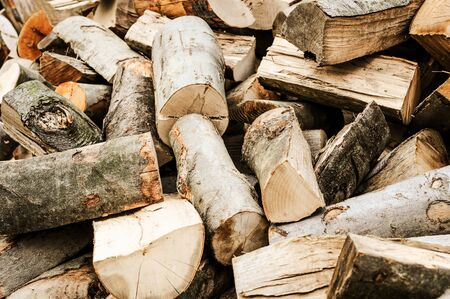 Concept image of preparing firewood for the winter - pile of chopped firewood ( vintage intensity effect)