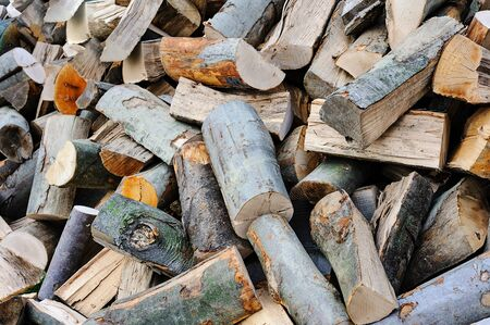 Concept image of preparing firewood for the winter - pile of chopped firewood.