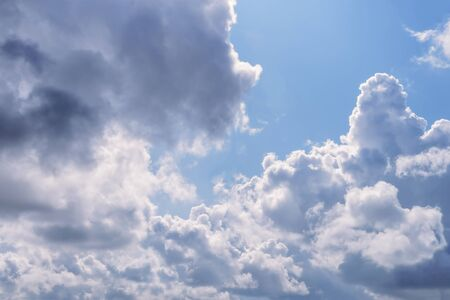 Picturesque sky background - intense clouds before raining on a blue sky. 写真素材
