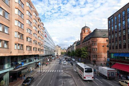 Stockholm, Sweden - August 09, 2019: View of The Vasagatan Street one of the main street in The Downtown of Stockholm with modern and historic building and urban traffic.