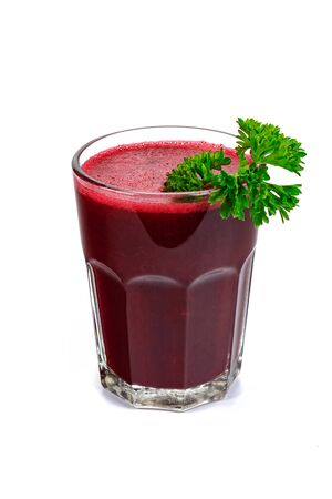 Fresh beet juice with parsley in a glass isolated on a white background Imagens