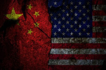 Composite image of US flag and China flag on the cracked rocky wall as a trade conflict concept Imagens