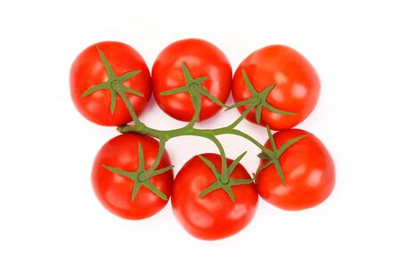 Top view of red fresh tomatoes with green leaves isolated on white background