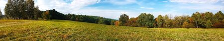 Wide panorama of an idyllic mountain landscape on a sunny autumn day Imagens