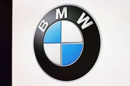 Nowy Sacz, Poland, October 28, 2019: BMW sign on a dealer advertisement banner.  BMW is a famous German automobile, motorcycle and engine manufacturing company.