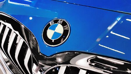 Nowy Sacz, Poland, October 28, 2019: BMW sign on a front of a car grill.  BMW is a famous German automobile, motorcycle and engine manufacturing company.