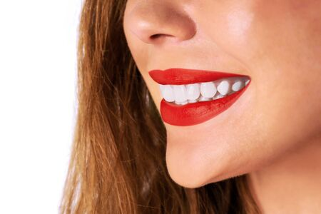 Dental care and whitening teeth concept - woman smiling and showing her healthy teeth in close-up Imagens