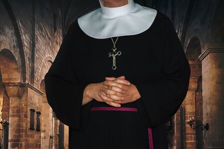 Religious life concept - unrecognized nun prays in the archival medieval monastery (mixed)