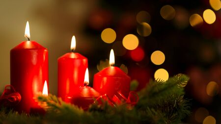 Holiday decoration - Romantic glowing candles on a background of beautiful bokeh lights