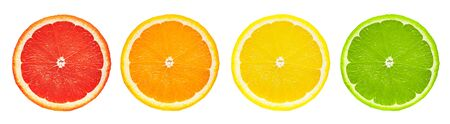 Group of fresh citrus fruits cut in half (grapefruit, orange, lemon, lime) in a row isolated on white background with clipping path 写真素材