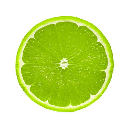 Perfect round slice of fresh lime fruit isolated on white background without shadows (high details) 写真素材