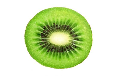 Perfect round slice of fresh kiwi fruit isolated on white background without shadows (high details)