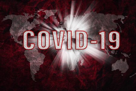 Composite image of global Coronavirus pandemic concept - red toned grunge world map with COVID-19 text