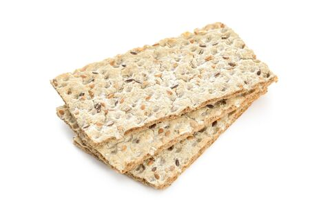 Stack of wholegrain dry crispy bread isolated on a white background in close-up