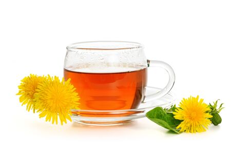Alternative medicine concept - glass cup of tea with fresh dandelion herbs Isolated on a white background