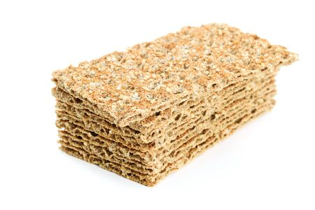 Stack of whole grain dry crispy bread with sesame isolated on a white background in close-up