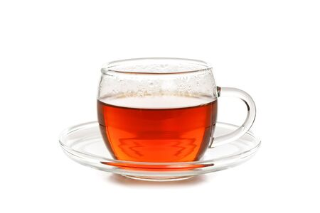 Studio shot of a glass cup of tea isolated on a white background in close-up