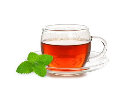 Studio shot of a glass cup of tea with mint leaf isolated on a white background in close-up Stock Photo