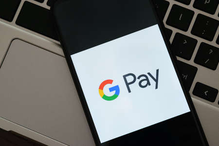 Krakow, Poland - September 30, 2020: GPay application sign on the screen smartphone. Google Pay is a famous digital wallet platform