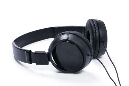 Modern black wired headphones isolated on a white background in close-up Standard-Bild