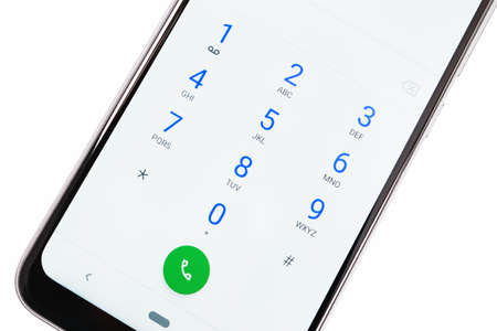 Modern smartphone screen with numbers dialing keypad in close-up on a white background Standard-Bild