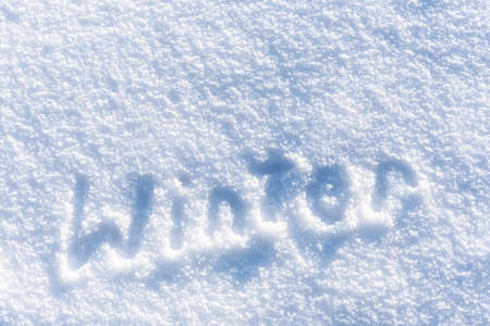 Full frame fresh snow texture background with winter text Standard-Bild - 157386056