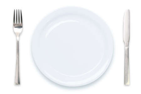 Cooking template - top view of an empty white plate with knife and fork isolated on a white background Standard-Bild