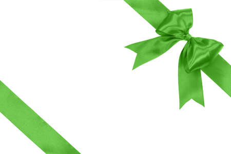 Gift card concept - shiny green satin ribbon with bow isolated on white background