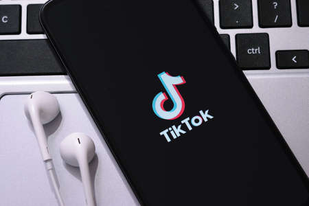 Krakow, Poland - October 16, 2020:  Tiktok sign on the smartphone screen. Tiktok is a famous social media network for share videos