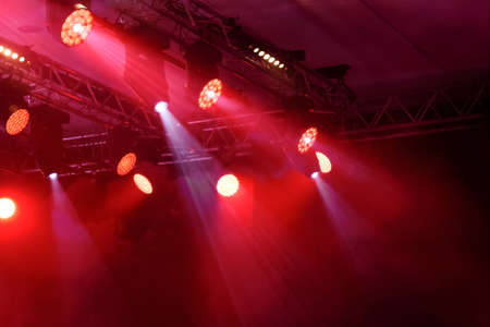 Professional entertainment lights in a music concert or disco night club as a background