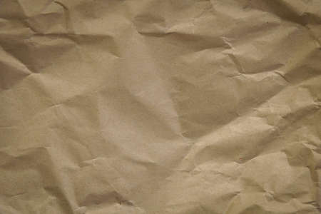Crumpled brown paper full frame texture background