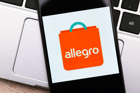 Krakow, Poland - November 08, 2020: Allegro sign on the smartphone screen. Allegro is a popular Polish shopping and auctions internet platform. Redactioneel