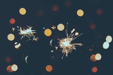 Christmas or New Year fireworks a a background of colorful bokeh lights (reduced tones) Stok Fotoğraf