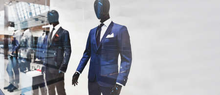 Wide advertisement shopping banner - template of a storefront with fashionable suits for men presented by mannequins with copy space for your ads