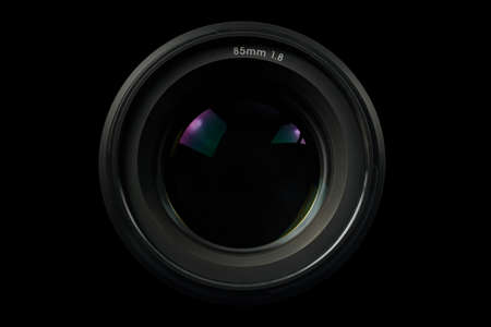Top view of a professional optical lens for modern DSLR cameras isolated on a black background. High resolution image. Stock fotó