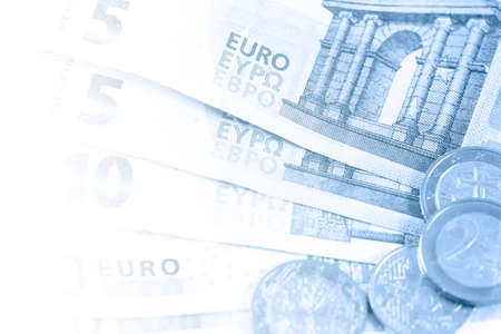 Financial background - blue toned image of many different Euro money in close-up with copy space.