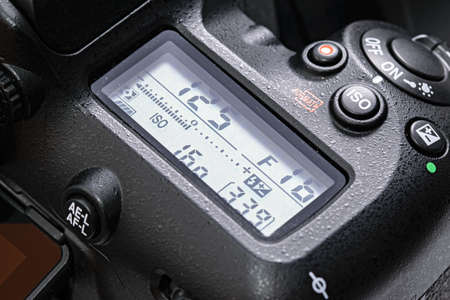 Krakow, Poland - April 09, 2021: Close-up of top lcd screen in Nikon D7500 DSLR camera. Nikon is a famous Japanese corporation specializing in optics and imaging products