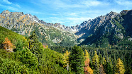 Majestic panoramic view of National Park High Tatras Mountains near Popradske Pleso in Slovakia on a sunny autumn day Stock Photo