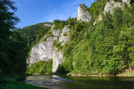 Picturesque view of the Dunajec River Gorge and canoeing tourists in the Pieniny National Park in Poland