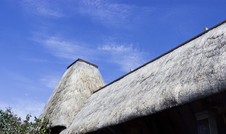thatched roof: Under the blue sky of the thatched roof Stock Photo