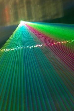 fantail: Color laser beams fantail in a haze and watter wall