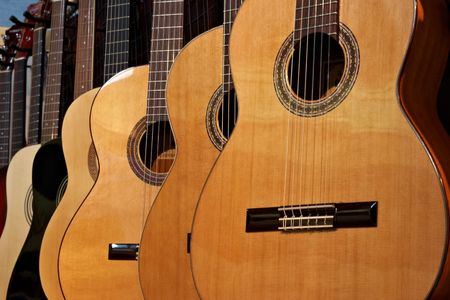 nylon string: Close-up of acoustic guitars in a music shop Stock Photo