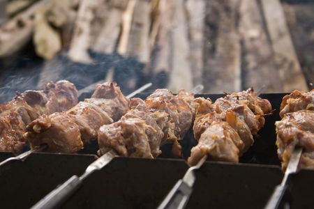 pices: Pices of pork grilled on skewers closeup