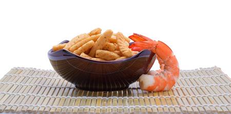 crunchy: crunchy prawn crackers on white background