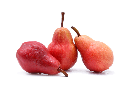 Three pears with water spots on a white background